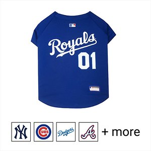 """Pets First MLB Dog & Cat Jersey, Kansas City Royals, Small; **Remember to measure your pet for the paw-fect fit.** Calling all baseball fans! Get your personal, four-legged mascot ready for game day with the Pets First MLB Dog & Cat Jersey. Sporting your favorite team\\\'s official name and logo, this high-quality jersey is designed with the look and feel of a real pro uniform—so your pet can feel like one of the gang. The fuzzy fastener closure is adorned with four faux buttons, while the screen-printed lettering and comfortable jersey fabric completes the authentic appeal. There's even an MLB """"property of"""" jock tag on the back that allows you to add a touch of personalization. Because win or lose, it's all about the look for your favorite MVP—most valuable pet, that is!"""