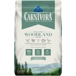 Blue Buffalo Carnivora Woodland Blend Grain-Free Adult Dry Cat Food, 10-lb bag; Let your cat eat just like she would in nature with Blue Buffalo Carnivora Woodland Blend Grain-Free Adult Dry Cat Food. It features 90% of its protein from 11 different animal sources including fresh, raw and dried chicken, turkey, saltwater fish and duck. This high-protein food contains nutrient-rich organs and cartilage to fulfill your kitty's natural instincts. It also has vitamins and minerals to give your favorite feline a complete and balanced diet with omega 3 and 6 fatty acids for skin and coat health. With no grains, peas or potatoes, Blue Buffalo Carnivora Woodland Blend Adult Dry Cat Food has the protein and nutrients to keep your companion going strong.