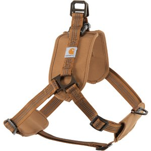 Carhartt Training Dog Harness, Brown, Medium; Keep your furry friend safe and secure with the Carhartt Training Dog Harness. This fully adjustable harness features durable straps of nylon webbing with duck canvas weave. It has edge binding on the pads to prevent fraying and abrasion with a heavy-duty plastic side release buckle and custom slotted metal D-ring for top and front lead. The chest and back pads are made of nylon canvas with water-repellent coating bonded to the neoprene cushion for comfort. This harness is also visible in low light situations as the webbing has reflective triple needle stitch. Get your paw-tner out and about with the Carhartt Training Dog Harness.