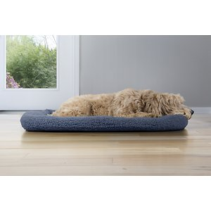 FurHaven Faux Sheepskin Bolster Dog Crate Mat, Blue, X-Large; Give your pal the beauty sleep he needs―at home or on the go―with the FurHaven Faux Sheepskin Bolster Dog & Cat Bed. It's made with ultra-plush, faux sheepskin for a super-snuggable sleeping surface your pal will love, and is fiber-stuffed to gently support his joints like elbows, hips, and back. Thanks to a quilted pad of insulating foam on the inside, it also keeps your doggy or kitty warm, wherever your adventures takes you. It's perfectly-sized to fit a kennel or crate, and sits perfectly on a car seat, next to an office chair, or any home away from home. Plus, it's machine-washable and has a water-resistant, polycanvas base to make cleaning it a cinch. It's available in different sizes to find the go-to bed for your pet.
