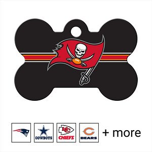 Quick-Tag Personalized NFL Bone Dog ID Tag, Large, Tampa Bay Buccaneers; Get your doggo ready to dig into the gridiron with the Quick-Tag NFL Bone Dog ID Tag. Made of solid brass, this bone-shaped tag is tough enough to stand up to all kinds of ruff-housing. The logo is cured using ultra-violet light for long-lasting durability. You can personalize it with up to four lines of laser-engraved text that could help you reunite with your pupper should he happen to go out of bounds one day. You'll even have enough room to add your fantasy football team name, a catchphrase or inside joke in addition to important emergency information such as a phone number, email address or medical condition. Whatever you decide, your doggo will paw-sitively love showing off his long-lasting loyalty to his favorite NFL team.