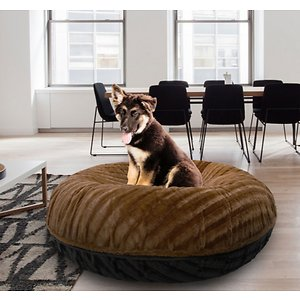 Bessie + Barnie Signature Extra Plush Faux Fur Classy Plain Bagel Dog & Cat Bed, Godiva Brown/Black, Small; Bessie + Barnie Signature Extra Plush Faux Fur Classy Plain Bagel Dog & Cat Bed will fool your pet into thinking she's sleeping on a cloud! This round plush sleeping haven is available in a wide range of colors and fashionable patterns. It's designed with a 360-degree zipper, so they are easy to clean and assemble! It even features a waterproof pillow liner for added protection from accidents and the covers are 100% machine washable and dryer friendly for hassle-free cleaning! And it's completely reversible so you can choose whichever side your pet pre-furs.