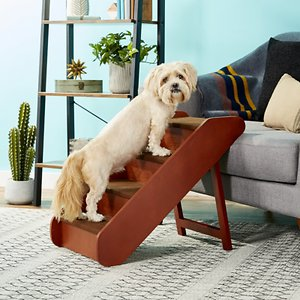 PetSafe CozyUp Folding Wood Pet Stairs, Large; Help your best pal reach his favorite cuddle spot with the PetSafe CozyUp Folding Wood Pet Steps. These durable wooden steps help furry companions up to 200 pounds get on and off the couch or bed without having to jump. The carpet covers on the steps provide traction for your pal's paws—helping him walk up and down the steps without slipping.  The steps feature a stylish cherry finish and can be easily folded and stored when not in use. It's a great way to protect your precious pal's joints and make it easier for him to curl up on his favorite furniture!