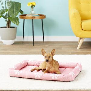 MidWest Paradise Teflon Fabric Protector Dog Crate Mat, Pink Floral, 30-in; Looking for the perfect pet bed for the rowdy pup? The MidWest Paradise Teflon Fabric Protector Pet Bed was created to keep your pet cool in the summer, warm in the winter. Made with a water-resistant, chew-resistant and durable material, this bed can repel pet stains, dirt and oils, so you can have less mess. Plus, it repels liquids, making accidents in bed a little less scary. It has a poly-fiber-filled bolster and cushioned base, so you know your pal will be comfortable. Plus, you easily put in a crate or carrier without adding to much bulk.