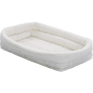 MidWest Quiet Time Deluxe Fleece Double Bolster Dog Crate Mat, 54-in; Spoil your best friend with the plush MidWest Quiet Time Deluxe Double Bolster Pet Bed. Designed to create a comfy and cozy place inside your dog\\\'s crate, the white fleece bed includes a large double-bolster that rolls up and act as a bumper around the metal perimeter. It comes with 4 elastic straps on the bottom to secure the bed to the corners of the pan. The straps also help keep the bed flat and resist the tendency to bunch up inside the crate. Best of all, the soft bed is machine washable and dryer friendly—simply follow directions on care tag.