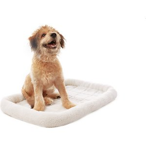 Frisco Quilted Dog Crate Mat, Ivory, 36-in; The Frisco Crate Mat Pet Bed makes your pet's crate, carrier, kennel, favorite spot or home away from home even cozier. The quilted bed is made with ultra-soft material with a foam pad on the bottom for extra cushioning. As your pet curls up and nestles into the perfect position, he can rest his head on the thick, comfy bolster that's filled with polyester fiber for added support. No matter whether you're traveling or simply crate training, your faithful companion will feel right at home with this snug, cozy mat. It also makes a quick and easy bed on its own and a safe spot for your pet when you're on the go. It comes in a variety of sizes to meet every pet's needs and fits most standard crates or carriers from 18 inches up to 54 inches. And for easy cleaning, you can throw it in the washer and dryer.