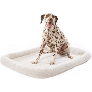 Frisco Quilted Dog Crate Mat, Ivory, 48-in; The Frisco Crate Mat Pet Bed makes your pet's crate, carrier, kennel, favorite spot or home away from home even cozier. The quilted bed is made with ultra-soft material with a foam pad on the bottom for extra cushioning. As your pet curls up and nestles into the perfect position, he can rest his head on the thick, comfy bolster that's filled with polyester fiber for added support. No matter whether you're traveling or simply crate training, your faithful companion will feel right at home with this snug, cozy mat. It also makes a quick and easy bed on its own and a safe spot for your pet when you're on the go. It comes in a variety of sizes to meet every pet's needs and fits most standard crates or carriers from 18 inches up to 54 inches. And for easy cleaning, you can throw it in the washer and dryer.